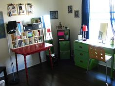 Eclectic home office. Love the red table. and the green desk!