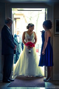 Bride silhouetted in the church doorway about to walk down the isle.  Wedding photography.  www.reillyimages.com