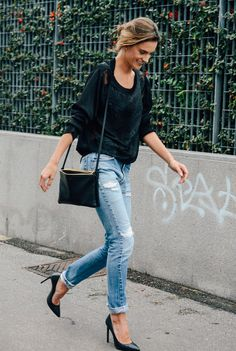Alessandra Ambrosio street style with black sweater, ripped jeans and black pointed shoes (September 2014). #alessandraambrosio  Be featured in Model Citizen App, Magazine and Blog.  www.modelcitizenapp.com