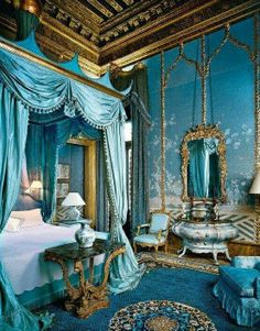 Intensely blue, extravagant Victorian bedroom furnishings. The ceiling is incredible.