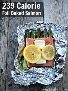 Easy 239 calorie baked salmon recipe with asparagus. The best part? This 30-minute recipe requires zero cleanup since the salmon is baked in foil pouches.