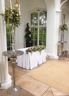 Ceremony flowers in the Orangery at St Audries Park. A Wilde Bunch design using our stylish silver Poseur Tables to add height to the candelabra designs. Bristol Channel, Wedding Venues, Wedding Ideas, Wedding Decorations, Table Decorations, Park Weddings, Candelabra, Summer Wedding, Wedding Flowers