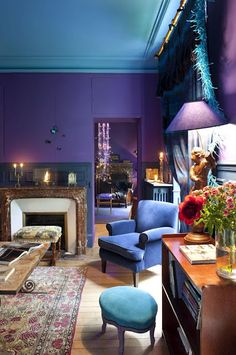 This designer was not afraid of color! Bold, saturated shades make the room cozy.  #shades of purple