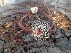 Handmade dreamcatcher bracelet featuring a beautiful carnelian stone. Check out the Crystal and Vein shop on Etsy! https://www.etsy.com/listing/202509708/carnelian-dreamcatcher-adjustable?ref=shop_home_active_7 #dreamcatcher #wirewrapped #carnelian #handmade #leather #adjustable #urban #boho #hipster #crystalandvein #stone #genuine #jewelry #bracelet