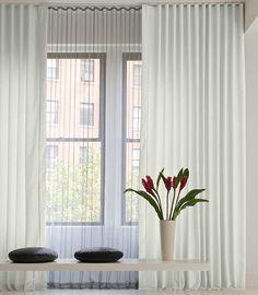 Remarkable folds and convenient functioning make our Ripple Fold curtains an ideal pick when looking for a modern day look. Great for large areas, Ripple Fold drapery could be used to bring together several windows or large expanses by overlaying the entire wall. Ripple Fold drapery slides through a low profile track that flawlessly blends with your ceiling or wall, which makes it a wonderful answer for corners, floor to ceiling windows and other difficult to access areas.