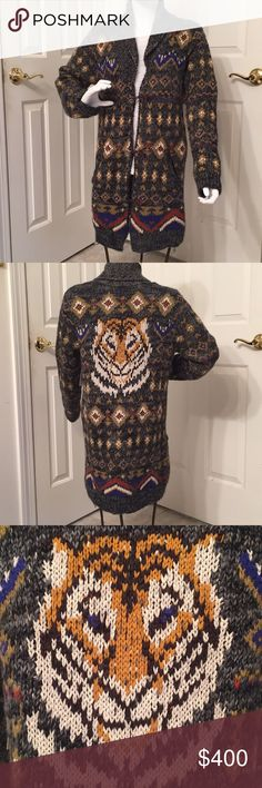 *VERY RARE* Free people Tiger Mascot Cardigan! •A rare find• As seen on Tv.  Highly sought after stunning multicolor pattern knit cardigan with tiger head design knitted on the back.  Simply a beautiful article of clothing to add to your wardrobe! Free People Sweaters Cardigans
