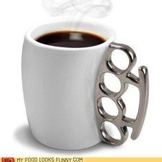 brass knuckles coffee mug?! haha, so perfect.
