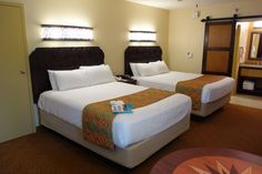 Improvements in the Refurbed Rooms at Disney's Caribbean Beach Resort from yourfirstvisit.net include new queen beds, sliding barn doors replacing the curtains hiding the bathroom and the addition of some Murphy beds.