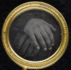 Button (1840s–50s). Miniature daguerreotype showing two hands resting on a book. Images and text courtesy The Met.