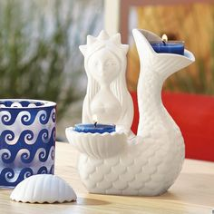 www.partylite.biz/alvita- More from Jonathan Adler--Fantastical mermaid brings nautical mystique to any space. Place a tealight in her tail and one in her shell for a beachy and bright presentation. 314-775-6822