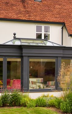 Orangery Extension and Loggia in Westbury Black - Westbury Black timber Orangery with large Roof Lantern - Orangery Extension Kitchen, Orangerie Extension, Kitchen Orangery, Cottage Extension, Garden Room Extensions, House Extensions, Orangery Roof, Orangery Conservatory, Roof Extension