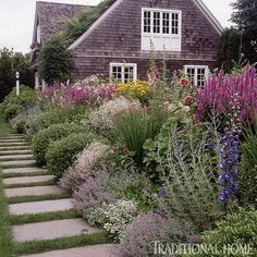 This traditional English cutting garden is loaded with peonies, lilies, dahlias, and other wonderful cutting flowers. - Traditional Home ® / Photo: William Stites / Design: Jane Lappin
