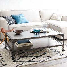 "$639 Antique Finish Coffee Table | west elm. 49""w x 28""d x 17""h."