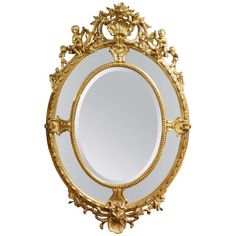 A Wonderful English 24K Water Gilt Oval Mirror Adorned with Cherubs and Shells | From a unique collection of antique and modern wall mirrors at https://www.1stdibs.com/furniture/mirrors/wall-mirrors/