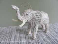 DIY animal ornaments (dollar store plastic animals covered in paper strips)