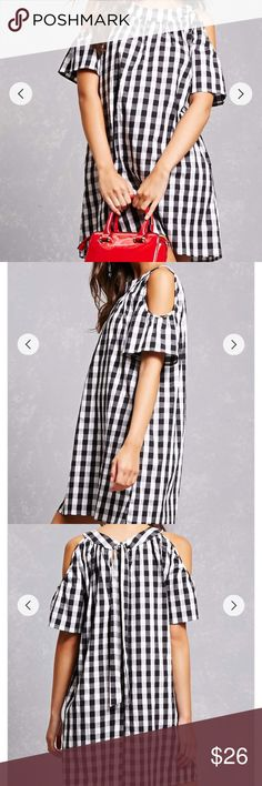 Black and white gingham cold sleeve dress Worn only twice. Very cute summer dress with cut outs in the shoulder. Flowy material and like new. Dresses
