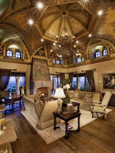 Nothing short of magnificent, this Old World living room pulls in elegant, Italian-inspired design elements to create an over-the-top and illustrious gathering spot. The hand-painted cathedral ceiling and Renaissance-style furnishings make a bold statement, creating a look that will immediately take you back in time. Design by Lori Venners. Architecture by Thom Oppelt. Image courtesy of Gene Northup of Synergy Sotheby's International Realty