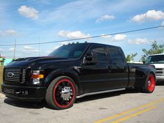 BLACK DUALLY W/ RED RIMS