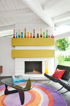 collection of brightly colored glass vases. and throw in a noguchi coffee table for good measure.