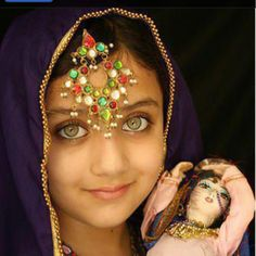 Afghan girl with her doll