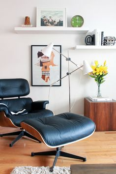 One day I will own an Eames chair and ottoman ... White leather and walnut would be perfection!