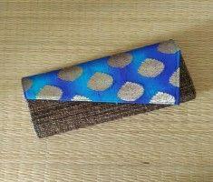Banana fibre clutch with blue silk shibori brocade