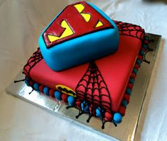 My first experience with Wilton's sugar sheets...not a fan.    Sweet Biscuit Bakery: Superhero cake!