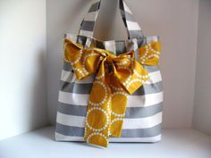 Hey, I found this really awesome Etsy listing at https://www.etsy.com/listing/122881946/large-bow-diaper-bag-made-of-grey-and