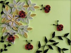 The only thing cuter than a ladybug is whole slew of them crafted out of perfectly rolled paper.