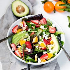 Strawberry Avocado Salad packed with heart-healthy fats, creamy goat cheese, toasted almonds and a light citrus poppy-seed dressing.