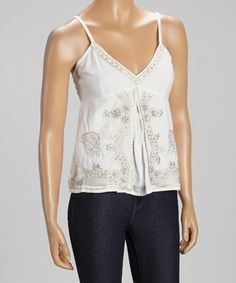Loving this White Flourish Embroidered Split Front Sleeveless Top on #zulily! #zulilyfinds