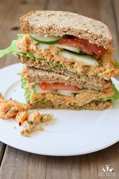 Fully loaded creamy mashed chickpea and veggie sandwich. I'll use hummus instead.