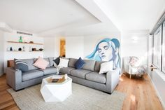 Mural artwork in living room as seen on The Block 2015. Contemporary and young living room with a hint of Scandinavian style. Click to see more photos from this living room.