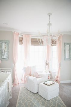 We love this perfect nook for nursing or cuddling with baby in this shabby chic nursery!