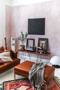 Bohemian home details - pink wall and leather sofa by BoConcept | Photo by Stella Harasek  | www.stellaharasek.com