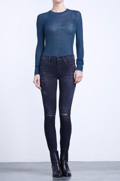 The classic high rise skinny that hugs the body from hip to ankle. The Rocket is a great fit that elongates the body for a slim and sexy silhouette. The dark grey wash has an understated easily adaptable feel. Dress the look up with blouse and heels or down with sneakers and a slouchy sweater. -High rise skinny -Stretch -Fits true to size -Fits just below the belly button -Ankle bone length -Tight through thigh tight through calf -Button and zipper fly -Rise: 9 3/4  -Inseam: 30 -Leg Opening…