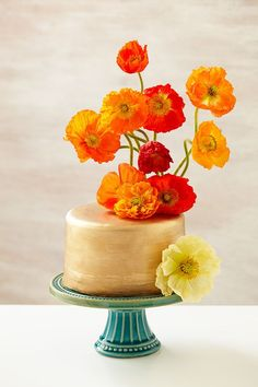 Gold #wedding cake with #poppies