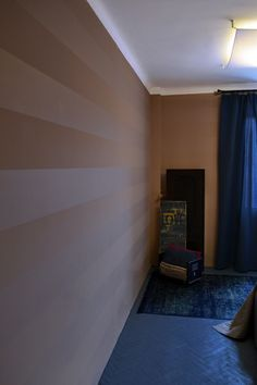 Great blue floor and curtains.  Pink/mauve wall with stripes.  Maszroom.com