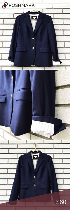 "J. Crew Factory Keating Boy Blazer In Navy J. Crew Factory Keating Boy Blazer In Navy Navy blue. Two gold crested buttons, four on each sleeve cuff. Notched collar. Faux welt pocket upper, two faux flap pockets at hips. Fully lined with white pinstriped lining in sleeves for an interesting roll up. 5.5"" vent. 38% wool, 30% polyester, 29% viscose, 3% spandex. Size 4. Excellent used condition. Measurements  Shoulder to hem 22.5"" Armpit to armpit 24"" Sleeve length 17"" J. Crew Factory Jackets…"