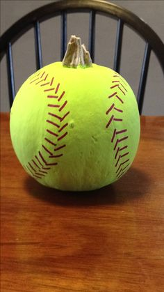 Softball pumpkin.  Craft glue & a fine-point Sharpie.  Can easily be done as a baseball, too.