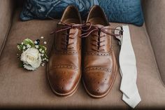 Michigan Summer San Marino Club Wedding by Kari Dawson Photography. Groom details, white bow tie, brown leather shoes, cream rose and baby's breath boutonniere.