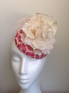 A personal favourite from my Etsy shop https://www.etsy.com/au/listing/512819137/cute-pink-and-cream-fascinator-with