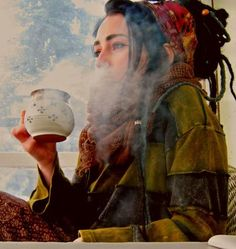 tea, steam, indoors, dreadlocks, hippy, chilled, side angle shot.