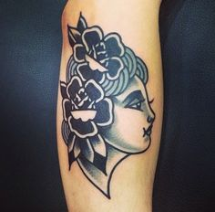 Traditional tattoo. Black and white women's face. Flowers tattoo. Love the simple look of this. Shading is nice too.