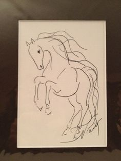 Pen sketch of horse rearing
