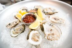 Raw Oysters on the Half Shell: Served with cocktail sauce, mignonette, lemon wedges.