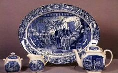 Over a quarter century has passed since the first Liberty Blue Staffordshire was made, many people have become interested in collecting this patriotic and attractive service.  Fifteen different historic scenes from the American colonial period were used on the dinnerware. The border has a mixture of wild flowers, and a historic scene in the center of each piece.