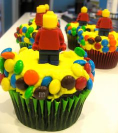 Have kids top their own cupcake with treats and a tiny lego man/creation