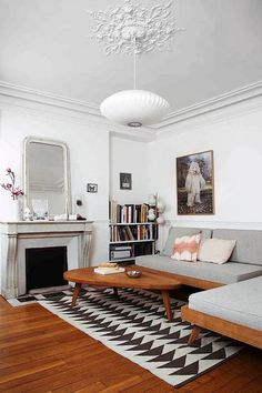 Gesa Hansen's Parisian apartment, furnished with key pieces from the Hansen Family Remix Collection, a Suki Cheema carpet and a George Nelson pendant
