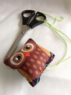 Never loose your scissors again with this pretty little handmade cotton owl print material scissors keeper. Keeper has a colorful cord, is padded and decorated with beads. (Scissors not included. Owl Print, Printed Materials, Pin Cushions, Pretty Little, Scissors, Sunglasses Case, Etsy Shop, Rock, Beads